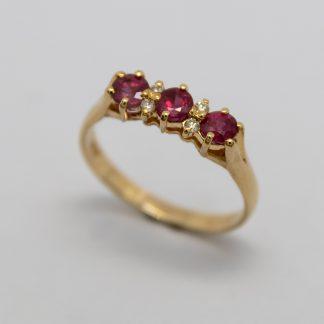 9ct Three Stone Ruby with Small Diamond Bridge Ring_0