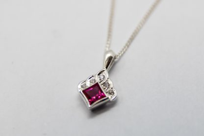 Stg Red Cubic Zirconian with a White CZ Pendan_0